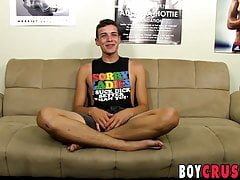 Interviewed twink playing with his cock and a dildo