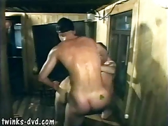 Two eager boys sharing their gay buddy in sauna