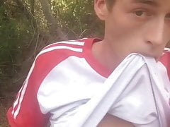 Young twink Craig Kennedy cums on a naked hike in the woods