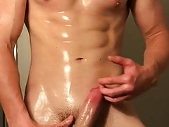 Sexy young stud wanks and busts a load