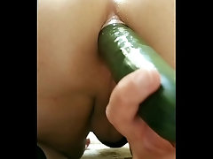 Working my ass with warm cucumber