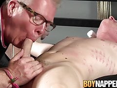 Twink gets restrained and then his old master sucks him off