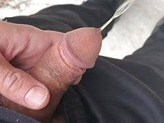twink pissing outside with cockring on